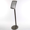 Full height view of black floor-standing A4 sign holder