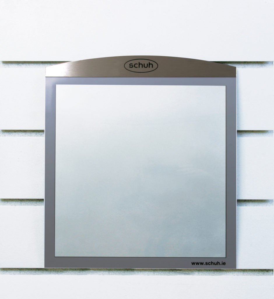 Wall mounted sign-holder for Schuh featuring an etch Schuh logo and the website address screen-printed onto the magentic film frame.